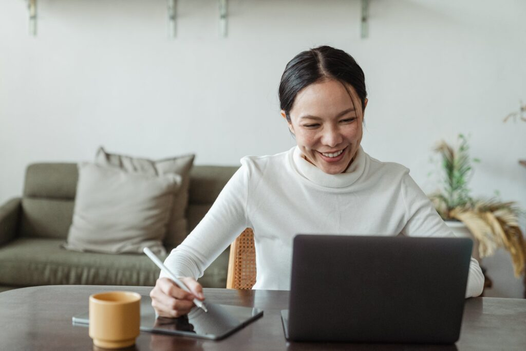 Women happily checking result in laptop